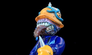 Frank Kozik × BlackBook Toy A Clockwork Hateball Hate Orange edition