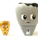 ↑木内歯科医院70周年記念ソフビ 臼歯のキューシーちゃん 虫歯(ミディアム)、臼歯のキューシーちゃんミニ ゴールドグリル
